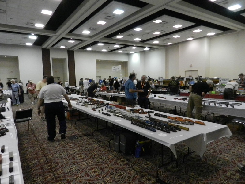 Looking toward the north end of the main room, about a quarter of the main hall with model display tables and vendors in the background.