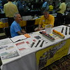 """Tim Dickinson (right) sits in for Paul Fedriconi (who was also strolling) at the Details West table - HO detail parts. <br /> John Gillies from Australia joins Tim.<br /> <a href=""""http://www.detailswest.com/"""">http://www.detailswest.com/</a>"""
