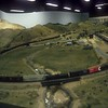 Crossing Tehachapi Creek and climbing out of Caliente, CA on the La Mesa HO-scale club.<br /> May 1985.