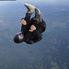 """PJ flips out the door. <br><span class=""""skyfilename"""" style=""""font-size:14px"""">2018-10-14_skydive_cpi_0005</span>"""