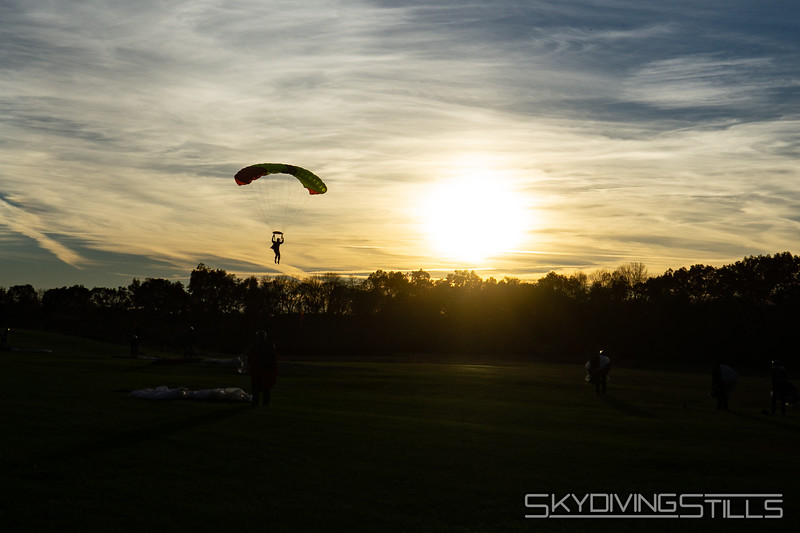 """Lia landing at sunset. <br><span class=""""skyfilename"""" style=""""font-size:14px"""">2018-11-04_skydive_cpi_0592</span>"""