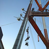 Three men descending the tower by ropes