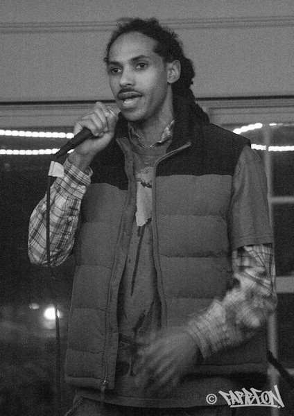 Self-Suffice at opening night poetry open mic.