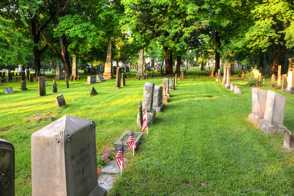 As with many cemeteries today, the graves of war veterans were marked with American flags