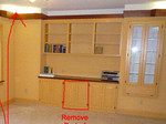 a remove part of built in cabinets to make desk