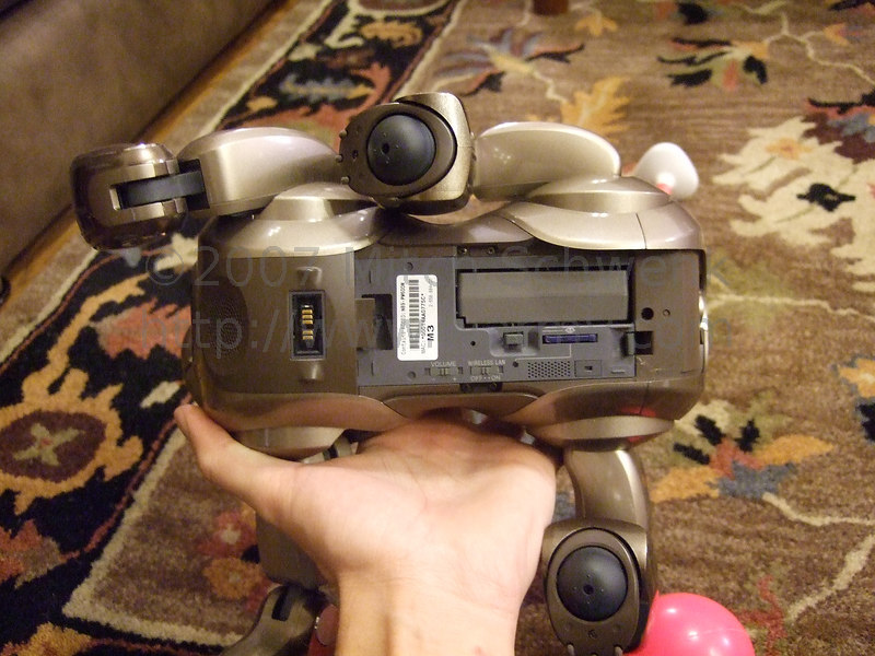 Aibo with h is undercarrage cover removed.
