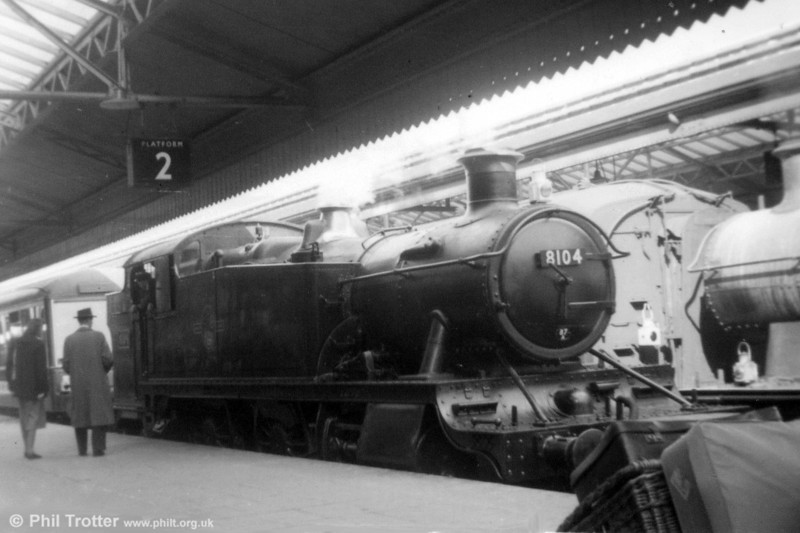A view of Neath-allocated GWR 5101 class 2-6-2T no. 8104 at Swansea High Street on 18th May 1957. Of interest to the rear of the locomotive is one of the two 'Devon Belle' Observation Cars, (nos. 13 & 14), both of which survive in preservation, no. 14 having recently been repatriated from the USA for use on the Swanage Railway