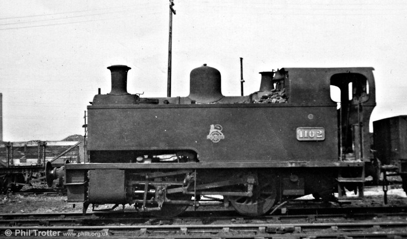 GWR Avonside 0-4-0T no. 1102 photographed at Danygraig, Swansea on 19th April 1953. Built in 1926, these six short-wheelbase locomotives (1101-1106) were always to be found on the Swansea Docks system, principally in use at the Kings and Queens Docks. Consequently, they were allocated to Danygraig Shed.