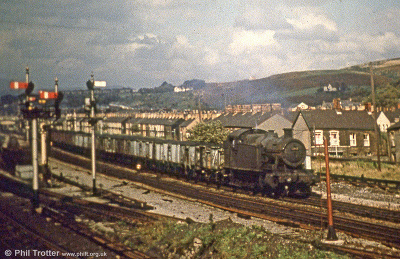 A class 42XX 2-8-0T passes Briton Ferry with a coal train in the early 1960s.
