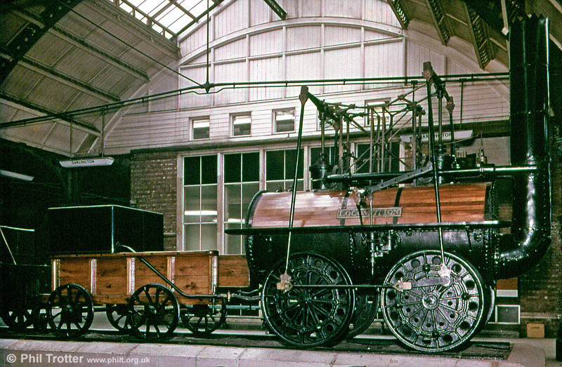 Stephenson 0-4-0 No. 1 'Locomotion' was built in 1925 and hauled the first train on the Stockton & Darlington Railway. It was withdrawn from service in 1846 but continued to reappear occasionally after that. It was sold for scrap in 1850 but became a pumping engine at Lucy Pit, Crook after which it returned to the NER and was restored for display in 1857. It was photographed while on display at Darlington Station.