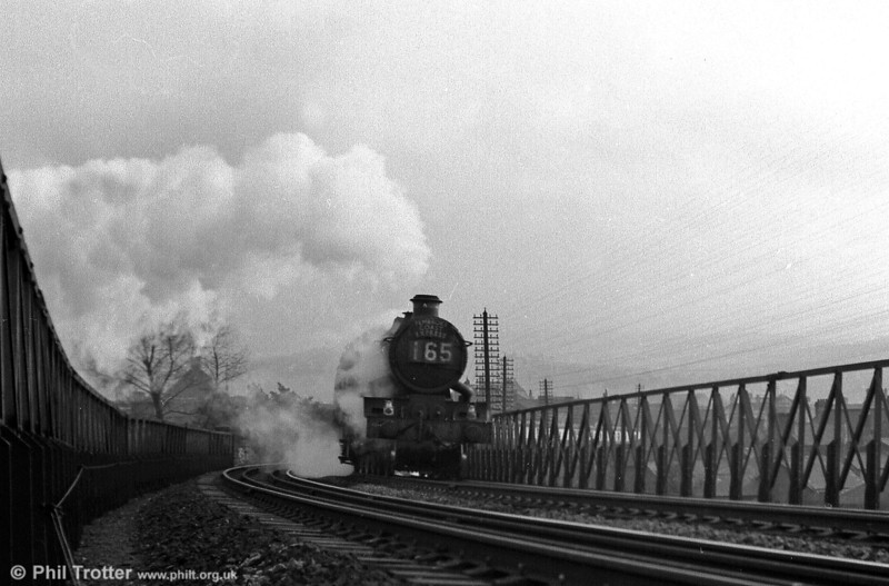 An unidentified 'Castle' class 4-6-0 begins the climb out of Neath General with the down Pembroke Coast Express. This was the 1055 Paddington - Pembroke Dock and was due through Neath non-stop at 1422.