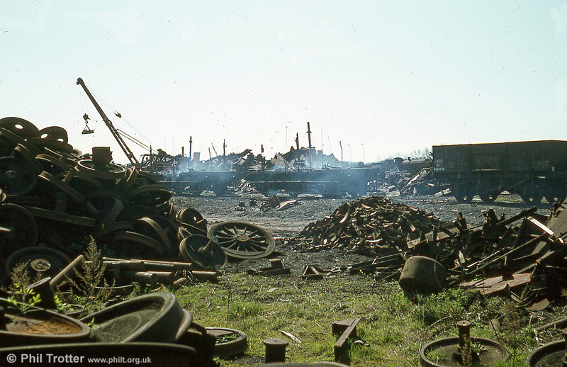 The smouldering remains of some scrapped BR brake vans. It was such work which saved so many locomotives from the torch.