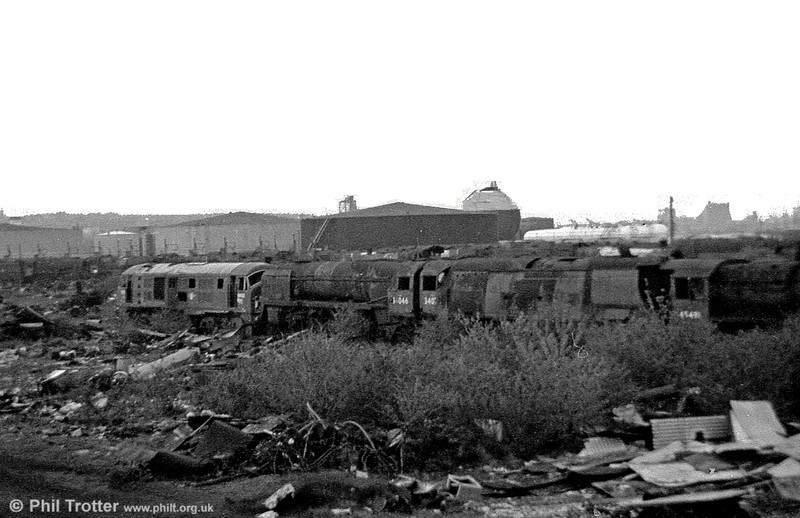 Another line-up at Barry. Identifiable (left to right) are type 2 Bo-Bo diesel D6122 cut up in June 1980, West Country Pacific 4-6-2 34046 'Braunton' and an unrebuilt 'Battle of Britain' class. Finally, on the right is the cab of class 5MT 4-6-0 no. 45491.