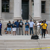 Speakers on the steps of Springfield City Hall address the crowd as volunteers paint a Black Lives Matter mural on Court Street in front of Springfield City Hall on Saturday. (Steven E. Nanton | Special to The Republican)