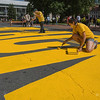 Volunteers paint a Black Lives Matter mural on Court Street in front of Springfield City Hall on Saturday. (Steven E. Nanton | Special to The Republican)