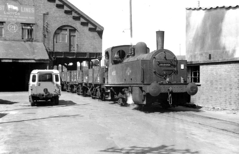 Midland Railway 0-4-0T no. 41535 passes the Coast Lines Warehouse in Swansea South dock in June 1964.<br /> For several years, this building was the base for the locomotives owned by the Railway Club of Wales, of which Brian was a founder member.<br /> Photo: Brian Owen