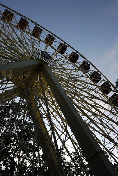 A large ferris wheel at sunset.  There is a deepening blue sky visible.