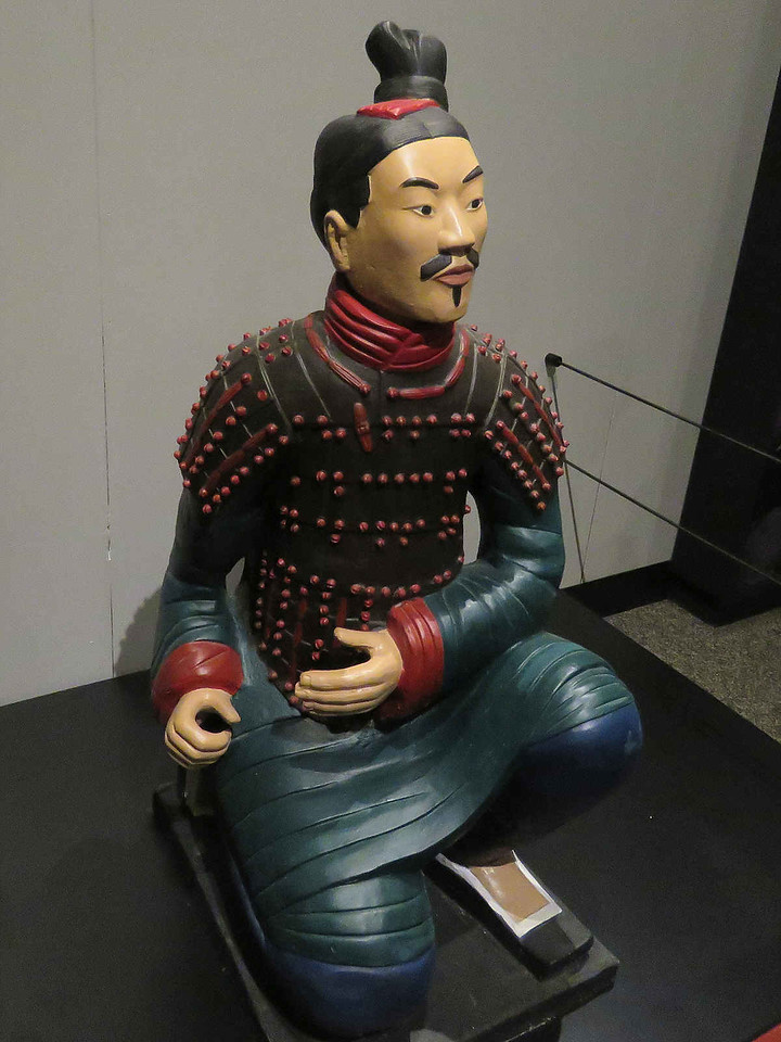 model of a terracotta warrior showing how they looked when lacquered and painted
