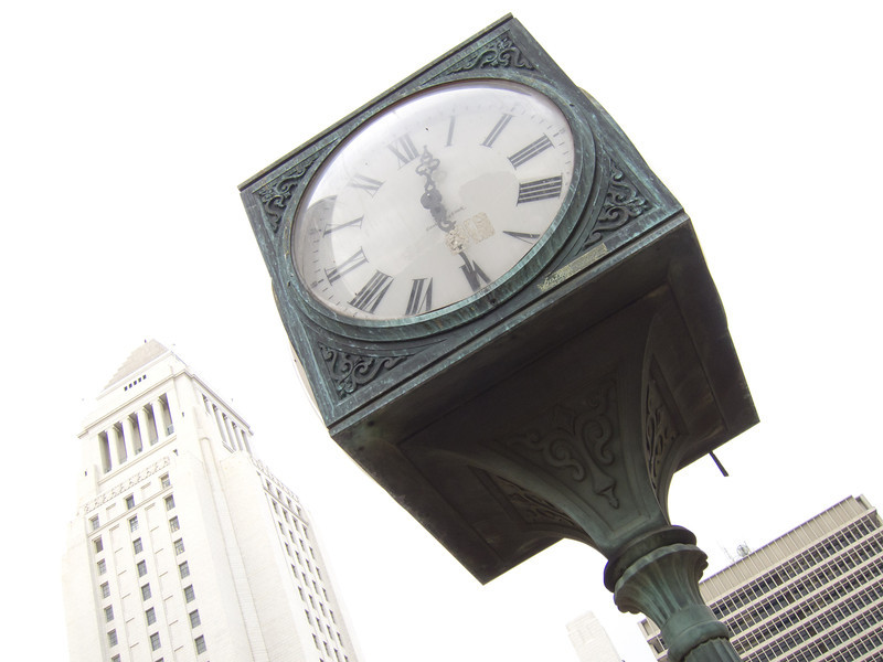 """<span  id=""""title"""">Cubical Clock</span> <em>Temple / Main</em> This is across the street from where we met to start the walk. I never  understood the deal with these giant clocks. They're kind of cool, but  kind of random."""