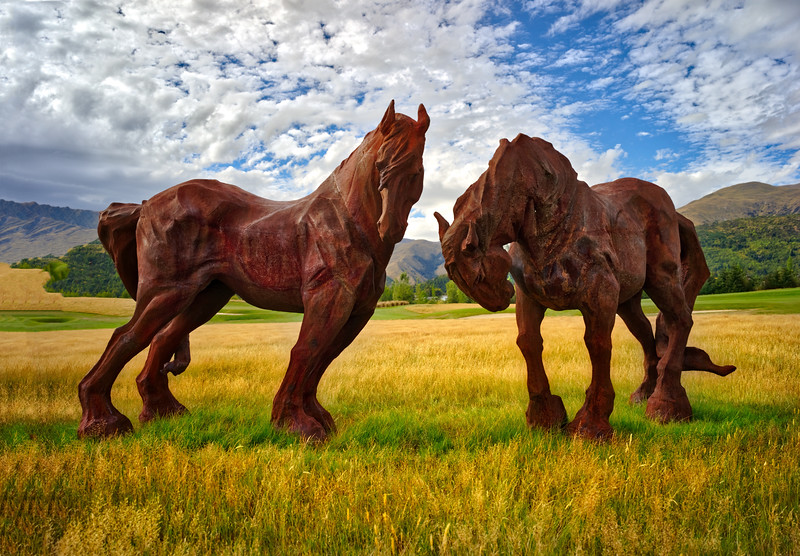 Sculpted horses in a field in Arrowtown, New Zealand.