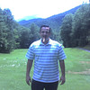golfnc_02_nagy_poses_with_cigar_on_11_tee_sapphire_mt_081106