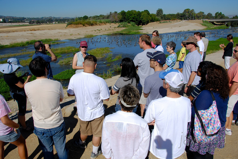 """<span id=""""title"""">Learning</span> Stop 1: Sepulveda Basin Our fearless leader, Jenny Price, talks to the group about the river while 100+ geese hang out in the water. She started by having us repeat """"LA is not a desert!"""""""