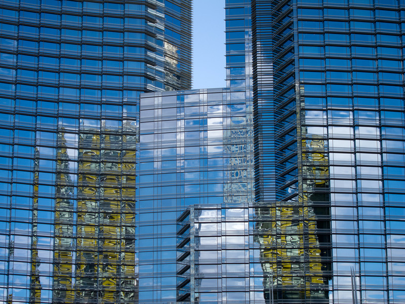 "<span id=""title"">Reflections</span> Windows at Aria reflect the twin leaning yellow towers next to it."