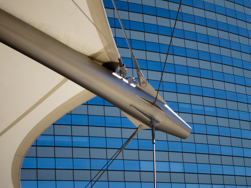 """<span id=""""title"""">Architectural Details</span> I have no idea what to call any of this... a big metal poles with cables and a sail attached to it, I guess. I mostly liked the windows as a background."""