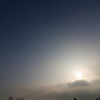 Sun breaking through the early morning fog