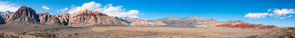 A big panorama from the Red Rock Overlook on HIghway 159 about a mile south of the BLM entrance. The big mountain at the left is Rainbow Mountain (6801').  The striped one is Bridge Mountain (6955).  The Red Rocks themselves are at the rgiht.