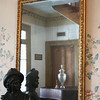 According to legend, the spirit of one of the house's former residents is trapped in this mirror.  Every time the glass has been replaced, the exact same markings keep reappearing...