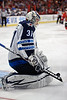Winnipeg goalie Ondrej Pavelec (31) makes a save during the NHL game between the Chicago Blackhawks and the Winnipeg Jets at the United Center in Chicago, IL. The Blackhawks defeated the Jets 4-3.