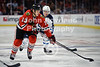 Chicago left wing Daniel Carcillo (13) sets to shoot during the NHL game between the Chicago Blackhawks and the Winnipeg Jets at the United Center in Chicago, IL. The Blackhawks defeated the Jets 4-3.
