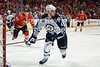 Winnipeg defenseman Zach Bogosian (4) chases after a loose puck during the NHL game between the Chicago Blackhawks and the Winnipeg Jets at the United Center in Chicago, IL. The Blackhawks defeated the Jets 4-3.