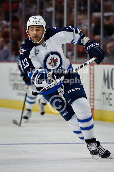Featured in Sports Illustrated.  Winnipeg defenseman Dustin Byfuglien (33) during the NHL game between the Chicago Blackhawks and the Winnipeg Jets at the United Center in Chicago, IL. The Blackhawks defeated the Jets 4-3.
