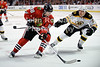 Chicago center Patrick Kane (88) drives to the goal while being defended by Boston defenseman Andrew Ference (21) during the NHL game between the Chicago Blackhawks and the Boston Bruins at the United Center in Chicago, IL. The Bruins defeated the Blackhawks 3-2 in a shootout.