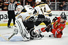 Boston goalie Tim Thomas (30) makes a save as Chicago center Jonathan Toews (19) goes after the rebound during the NHL game between the Chicago Blackhawks and the Boston Bruins at the United Center in Chicago, IL. The Bruins defeated the Blackhawks 3-2 in a shootout.