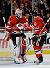 Chicago goalie Corey Crawford (50) congratulates Chicago defenseman Duncan Keith (2) after Keith scored a 2nd period goal during the NHL game between the Chicago Blackhawks and the Edmonton Oilers at the United Center in Chicago, IL. The Blackhawks defeated the Oilers 6-3.