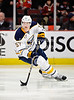 Buffalo defenseman Tyler Myers (57) skates with the puck during the NHL game between the Chicago Blackhawks and the Buffalo Sabres at the United Center in Chicago, IL. The Blackhawks defeated the Sabres 6-2.
