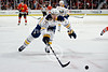 Buffalo defenseman Marc-Andre Gragnani (17) chases down a puck during the NHL game between the Chicago Blackhawks and the Buffalo Sabres at the United Center in Chicago, IL. The Blackhawks defeated the Sabres 6-2.