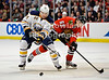 Buffalo defenseman Andrej Sekera (44) battles for the puck with Chicago right wing Michael Frolik (67) during the NHL game between the Chicago Blackhawks and the Buffalo Sabres at the United Center in Chicago, IL. The Blackhawks defeated the Sabres 6-2.