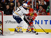 Chicago left wing Andrew Brunette (15) is checked behind the net by Buffalo defenseman Tyler Myers (57) during the NHL game between the Chicago Blackhawks and the Buffalo Sabres at the United Center in Chicago, IL. The Blackhawks defeated the Sabres 6-2.