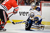 Buffalo goalie Jhonas Enroth (1) is unable to stop a shot by Chicago right wing Marian Hossa (81) during the NHL game between the Chicago Blackhawks and the Buffalo Sabres at the United Center in Chicago, IL. The Blackhawks defeated the Sabres 6-2.