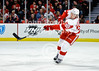 Detroit defenseman Niklas Kronwall (55) clears the puck during the NHL game between the Chicago Blackhawks and the Detroit Red Wings at the United Center in Chicago, IL. The Red Wings defeated the Blackhawks 3-2 in overtime.