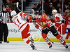 Detroit right wing Daniel Cleary (11) tries to get past Chicago right wing Jimmy Hayes (39) during the NHL game between the Chicago Blackhawks and the Detroit Red Wings at the United Center in Chicago, IL. The Red Wings defeated the Blackhawks 3-2 in overtime.