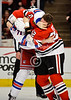 Chicago left wing Brandon Bollig (52) and New York left wing Mike Rupp (71) fight during the NHL game between the Chicago Blackhawks and the New York Rangers at the United Center in Chicago, IL. The Blackhawks defeated the Rangers 4-3.