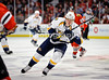 Nashville right wing Martin Erat (10) chases after the puck during the NHL game between the Chicago Blackhawks and the Nashville Predators at the United Center in Chicago, IL. The Predators defeated the Blackhawks 3-1.