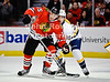 Chicago left wing Andrew Brunette (15) and Nashville defenseman Jack Hillen (38) fight for position in front of the net during the NHL game between the Chicago Blackhawks and the Nashville Predators at the United Center in Chicago, IL. The Predators defeated the Blackhawks 3-1.