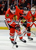Chicago right wing Jimmy Hayes (39) clears a loose puck during the NHL game between the Chicago Blackhawks and the Nashville Predators at the United Center in Chicago, IL. The Predators defeated the Blackhawks 3-1.