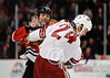 Chicago right wing Jamal Mayers (22) and Phoenix center Kyle Chipchura (24) fight during the NHL game between the Chicago Blackhawks and the Phoenix Coyotes at the United Center in Chicago, IL. The Coyotes defeated the Blackhawks 4-3 in a shootout.
